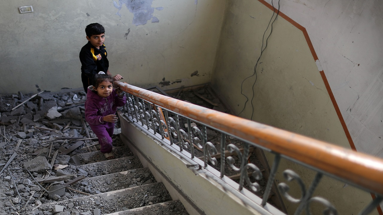 A Palestinian girl walks up the stairs of her family house that was damaged in an Israeli air strike, in Gaza City (Image:Reuters)