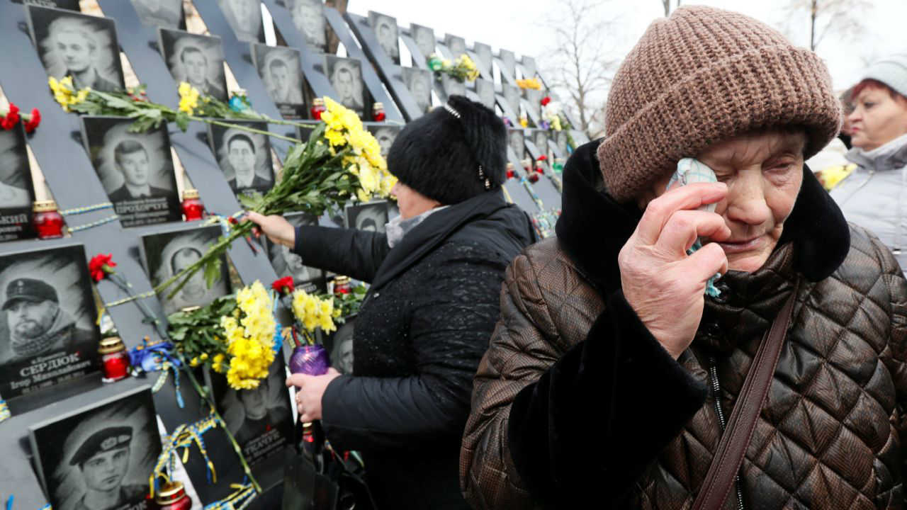 """People attend a commemoration ceremony at a monument to the so-called """"Heavenly Hundred"""", the anti-government protesters killed during the Ukrainian pro-European Union (EU) mass demonstrations in 2014, to mark the fifth anniversary of the start of the uprising in Kiev, Ukraine. (Reuters)"""