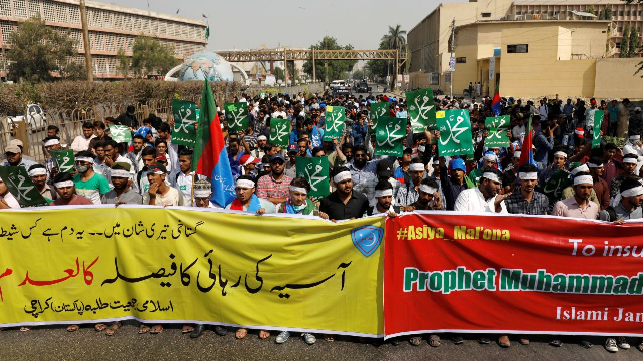 "Supporters of Jamiat Talaba Islam (JTI), student wing of religious and political party Jamaat-e-Islami (JI) hold signs as they chant slogans after the Supreme Court overturned the conviction of a Christian woman sentenced to death for blasphemy against Islam, during a protest in Karachi, Pakistan. The writing on the yellow banner reads in Urdu, ""the verdict of releasing Asia should be declared null and void""; the placards read: ""Ready to sacrifice our life for Mohammad"". (Reuters)"