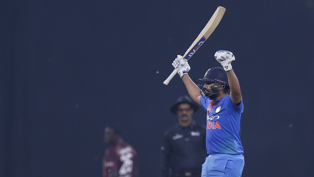 Rohit Sharma became the first man to score four T20I centuries as he brought up his 100 off just 58 deliveries in the final over. The Indian skipper stitched together a quick-scoring 62-run partnership off just 28 balls with KL Rahul to give India a commanding total of 195/2 after 20 overs. (Image: AP)