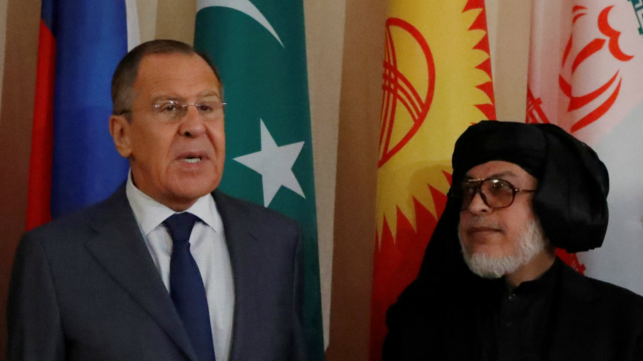 Russian Foreign Minister Sergei Lavrov and Sher Mohammad Abbas Stanakzai, head of the Taliban's political council in Qatar, pose for a phoTO during the multilateral peace talks on Afghanistan in Moscow, Russia. (Image: Reuters)