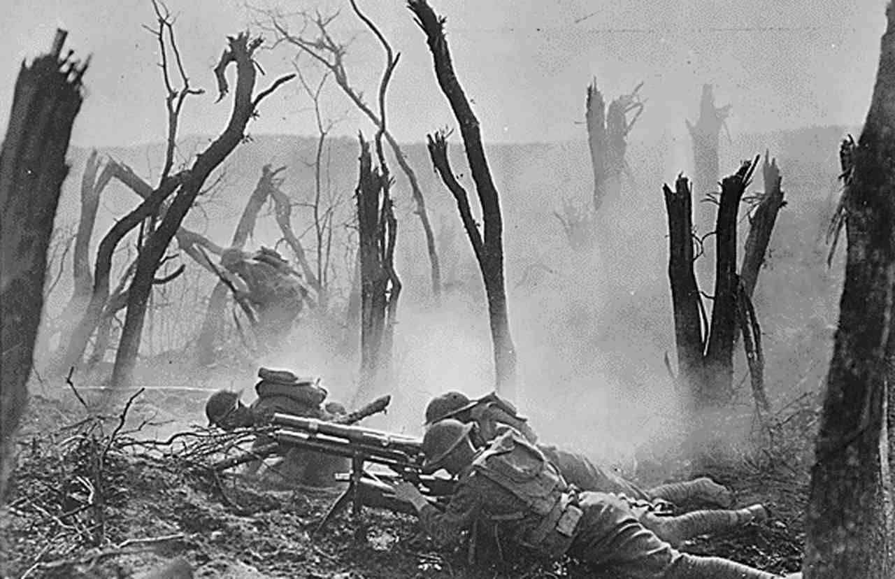 Pictured: An American troupe from Regimental Headquarters Company, 23rd Infantry, shoots a 37mm gun, advancing against German entrenched positions. (Image: Reuters)
