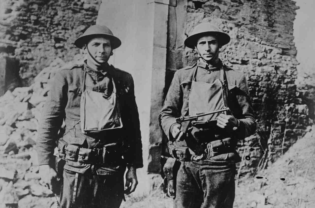 Pictured: Two American soldiers, James H. White and Corporal Howard Thompson, who were part of a group that killed and captured several Germans in no man's land. Thompson holds a pistol taken from a German soldier killed by White. (Image: Reuters)