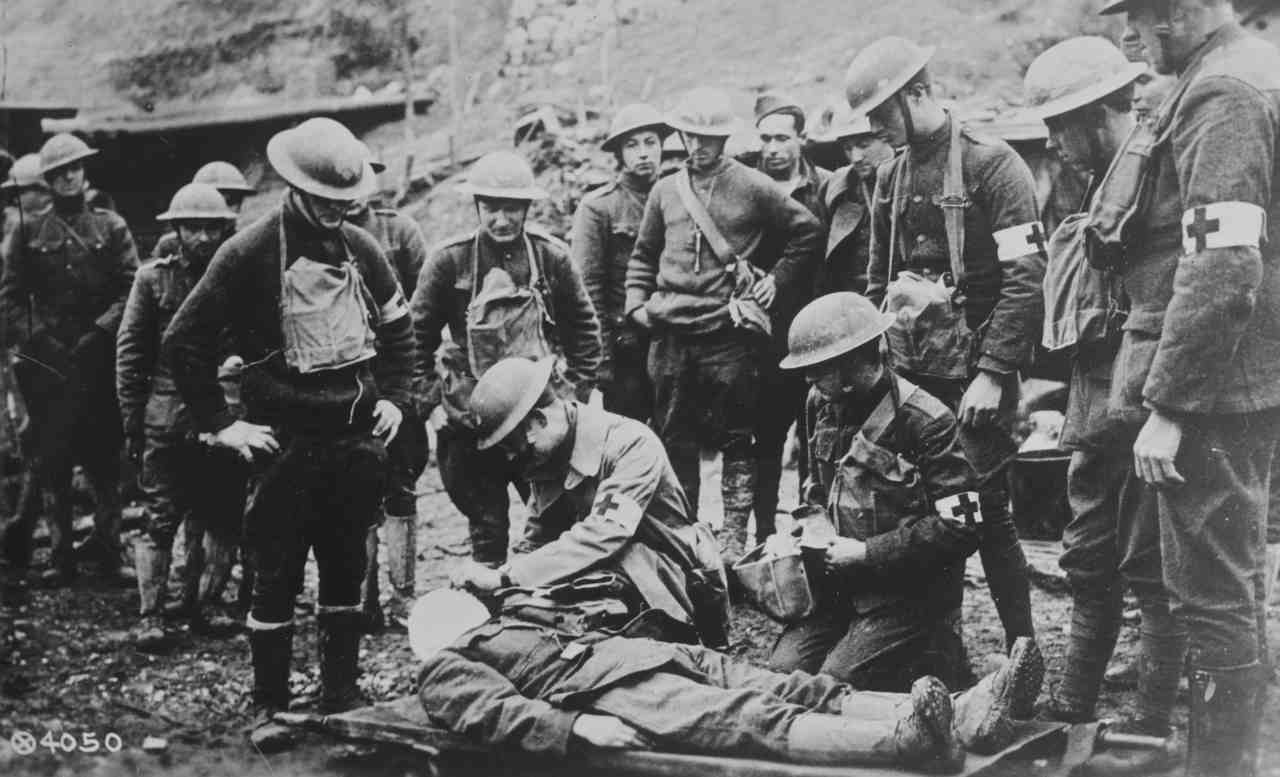 Pictured: A doctor from the American Expeditionary Force tends to an injured soldier. (Image: Reuters)