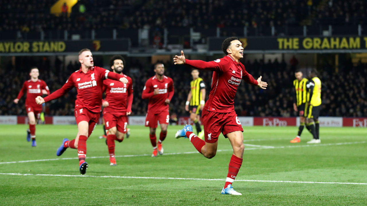 Watford 0 - 3 Liverpool | Goals from Mohamed Salah (67') and Roberto Firmino (89') scored on the either side of a stunning freekick by Trent Alexander-Arnold in the 76th minute helped the Reds win against Watford at Vicrage Road. The match also saw Liverpool captain Jordan Henderson being dismissed in the 82nd minute for picking two yellow cards. The victory helped Liverpool extend its unbeaten run in the League to 13 matches and maintain pressure on table topping Manchester City. (Image: Reuters)