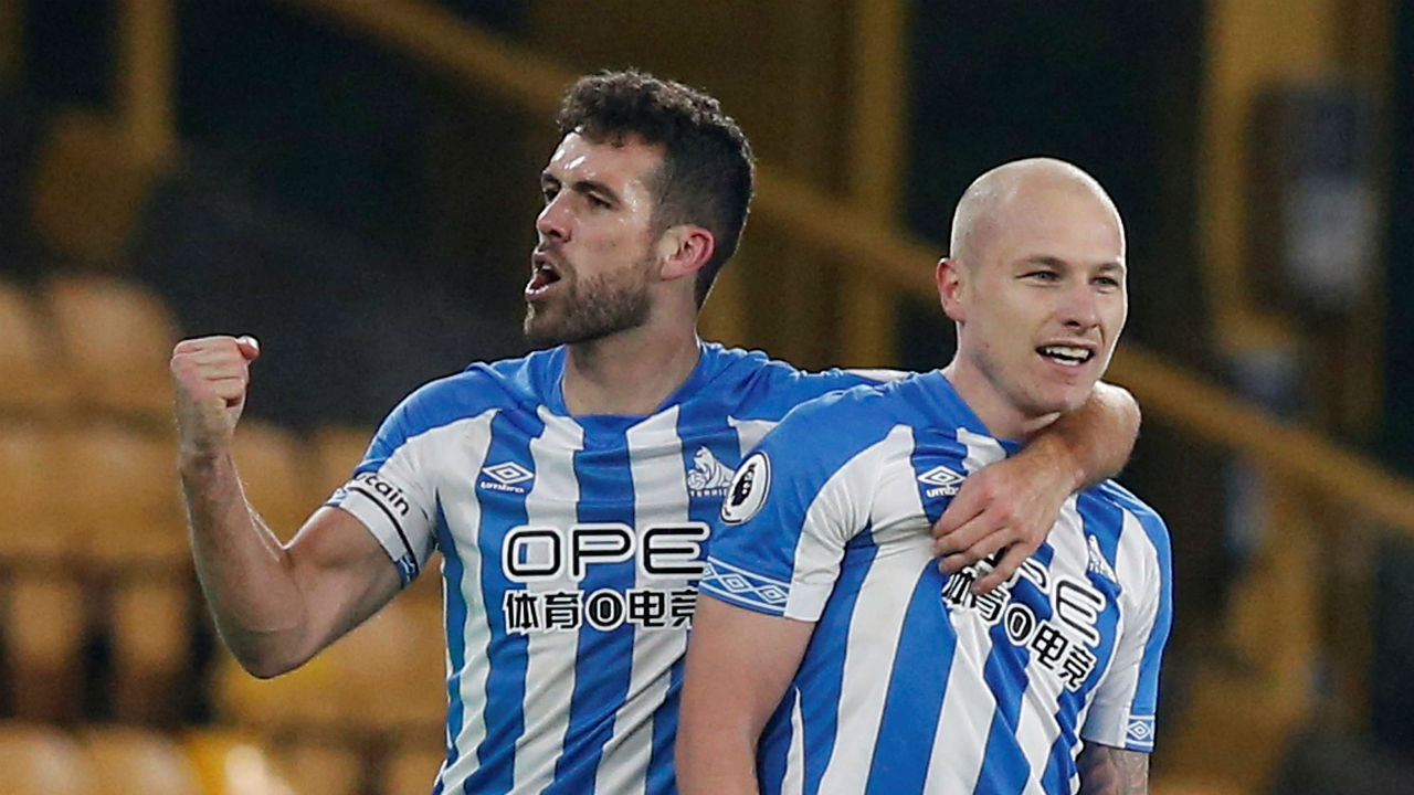 Wolverhampton Wanderers 0 - 2 Huddersfield Town | Aaron Mooy's brace (6' and 74') helped Huddersfield Town win their fixture against Wolves at Molineux Stadium. The win helped Huddersfield take a massive leap of six places onto 14th in the Premier League. Toothless Wolves suffered a fourth defeat in five games and remained 11th. (Image: Reuters)