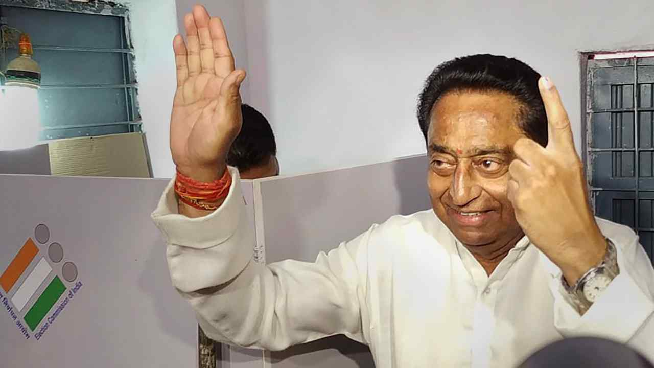 Madhya Pradesh Congress President Kamal Nath shows his ink-marked finger after casting vote for in Chhindwara. (Image: PTI)