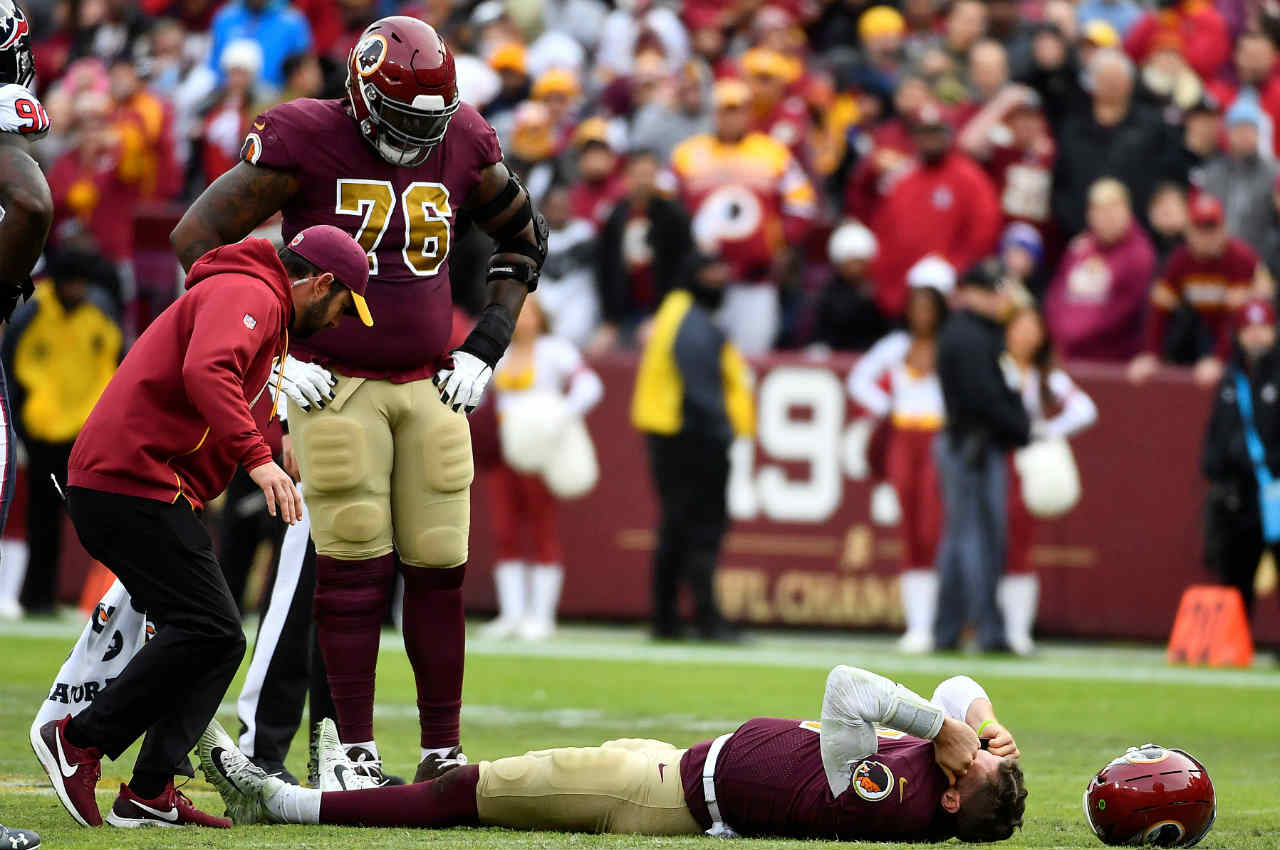 Washington Redskins quarterback Alex Smith fractured his right leg during a National Football League game against the Houston Texans. Smith broke two bones in his lower right leg in what could be a potentially career-ending injury. (Image: Reuters)
