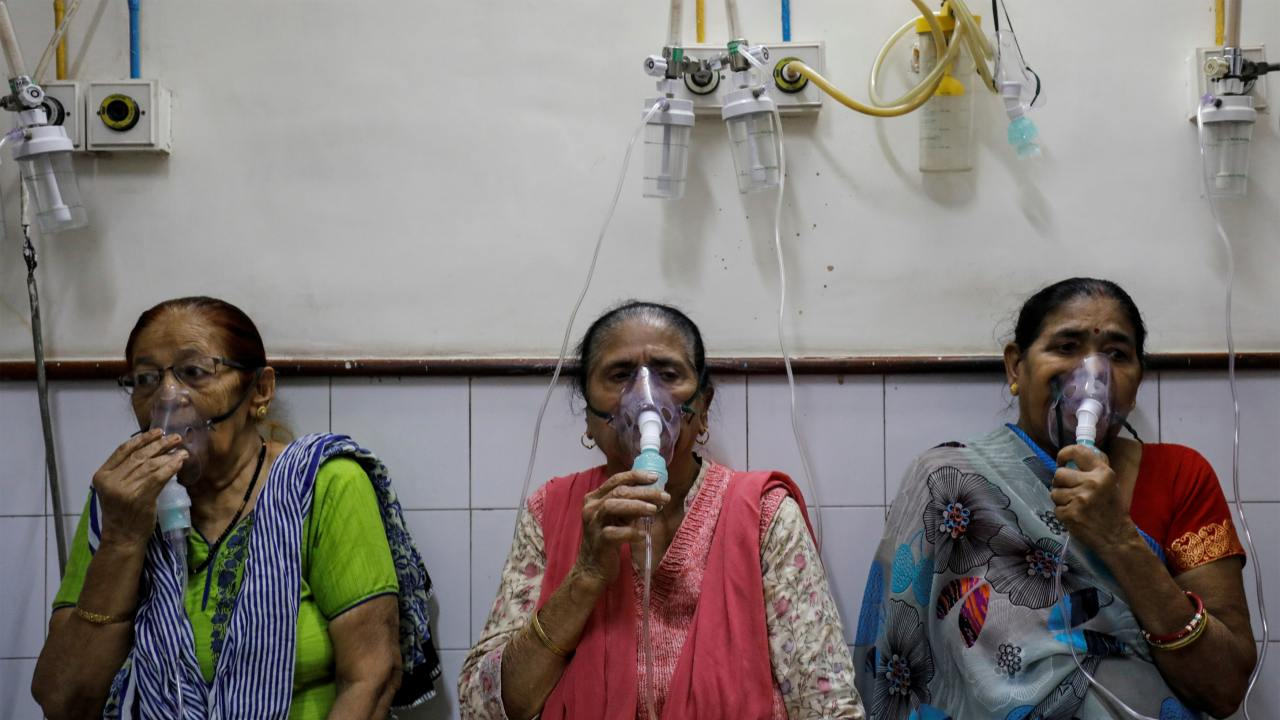 Women receive treatment for respiratory issues at a hospital in New Delhi. (Image: Reuters)