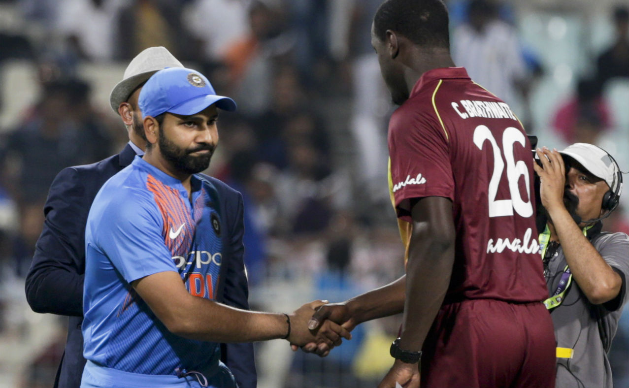 There were as many as five players who made their debuts when India and West Indies took the field for the 1st T20I of the three-match series at the Eden Gardens, Kolkata. India handed T20I debuts to Khaleel Ahmed and Krunal Pandya. Windies had three debutants in the form of Oshane Thomas, Fabian Allen and Khary Pierre. Rohit Sharma won the Toss and opted to bowl. (Image: AP)