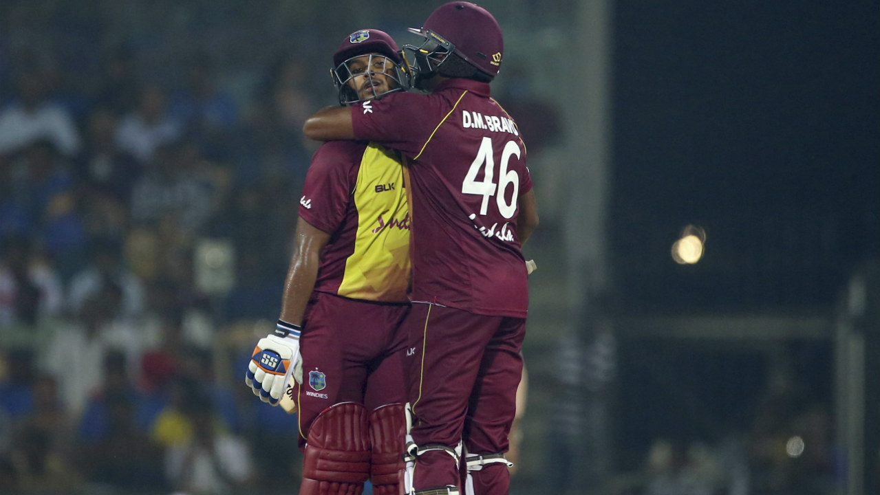 After the fall of Ramdin's wicket it was all one-way traffic as Nicholas Pooran and Darren Bravo tore into the Indian bowlers. Pooran brought up his half-century in the final over as their unbeaten 87-run partnership took the Windies to a commanding total of 181/3. (Image: AP)