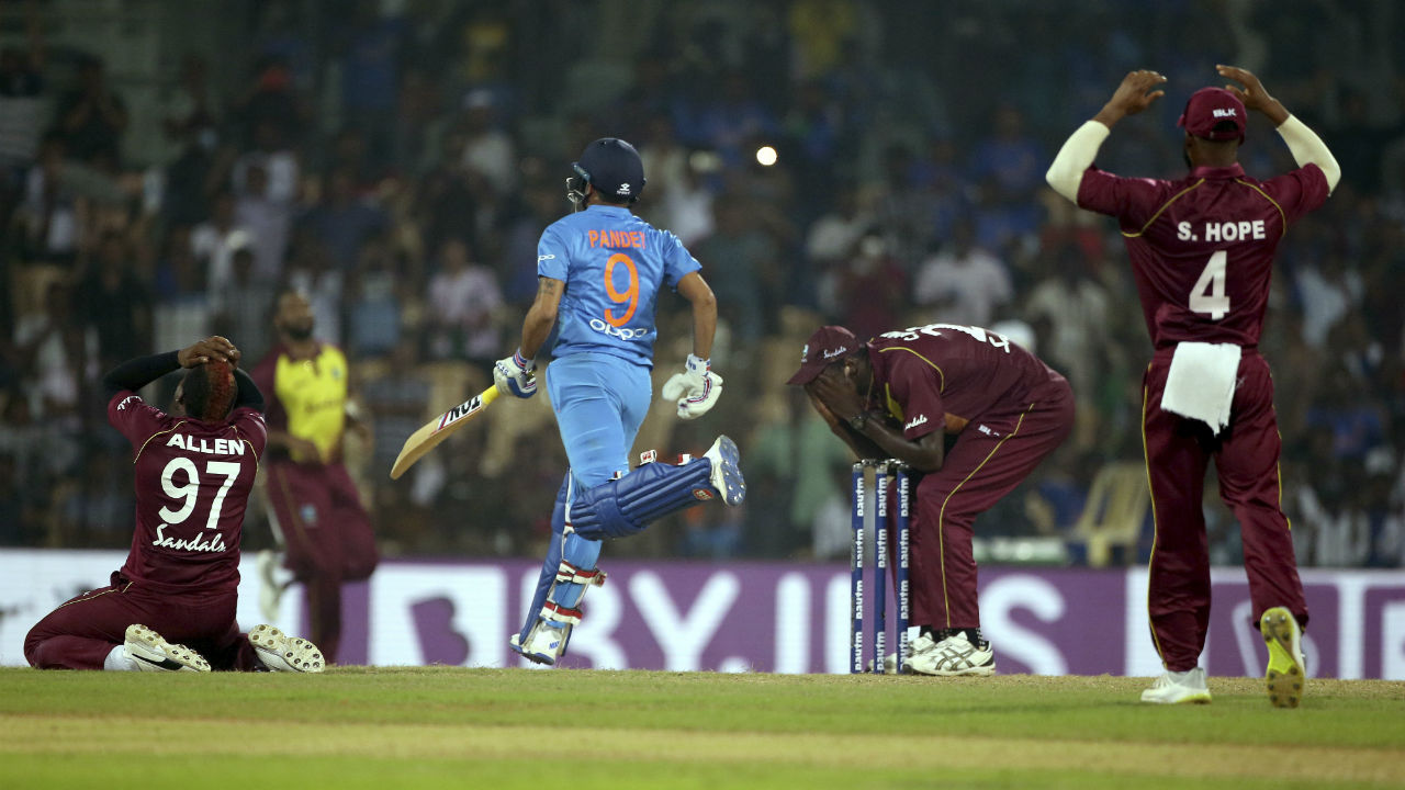 Manish Pandey tapped the final delivery straight down the ground and a fumble by Allen allowed the batsmen to complete the single as India clinched victory off the very last ball. India won the match by 6 wickets. (Image: AP)