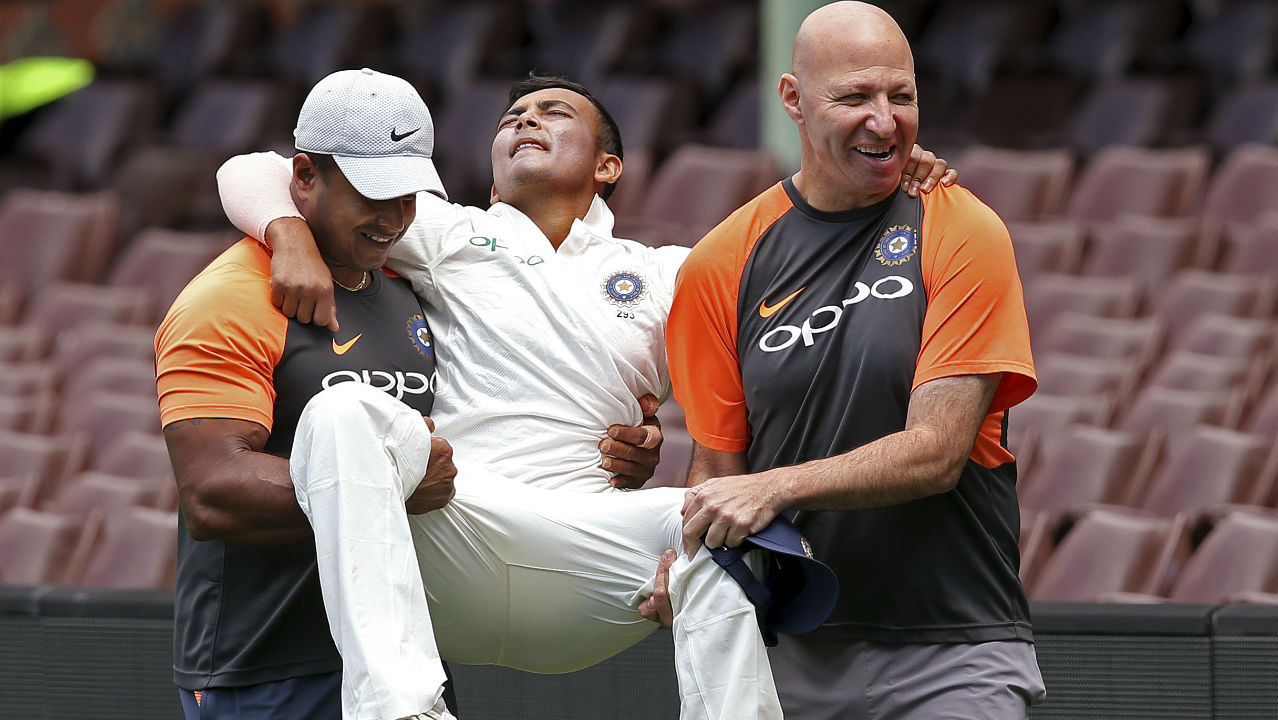 Prithvi Shaw injury | Shaw who marked his Test debut with a century against the Windies was set to open the batting Down Under before tragedy struck in the practice match against Cricket Australia XI. Shaw looked in great form en route to his 66 off 69-balls in the first innings before suffering an ankle injury while fielding. Cricket fans who were excited to watch Shaw take on the formidable Aussie bowling attack were left disappointed as the injury ruled him out of the Test series. (Image: AP)