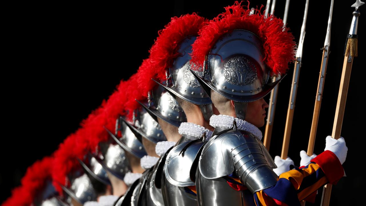"""Members of the Swiss Guard are seen before the Pope Francis' """"Urbi et Orbi"""" message at the Vatican. (Image: REUTERS)"""
