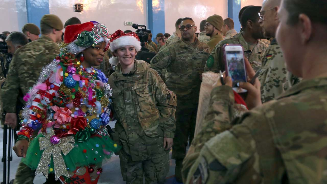 U.S. and NATO forces attend a ceremony on Christmas Day at the Resolute Support Headquarters, in Kabul, Afghanistan. (Image: AP)