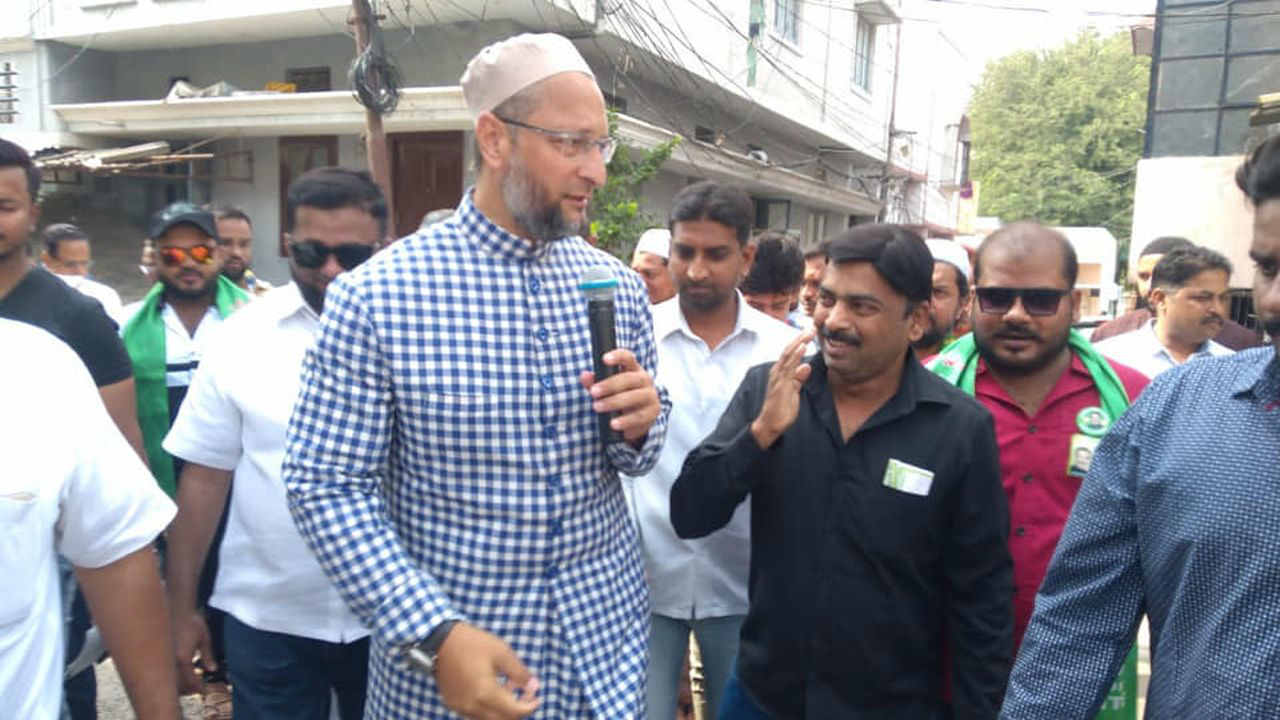 AIMIM President Asaduddin Owaisi along with his party candidate Ahmad Balala during door-to-door campaign in Malakpet assembly constituency (Image Facebook/@Asaduddinowaisi)