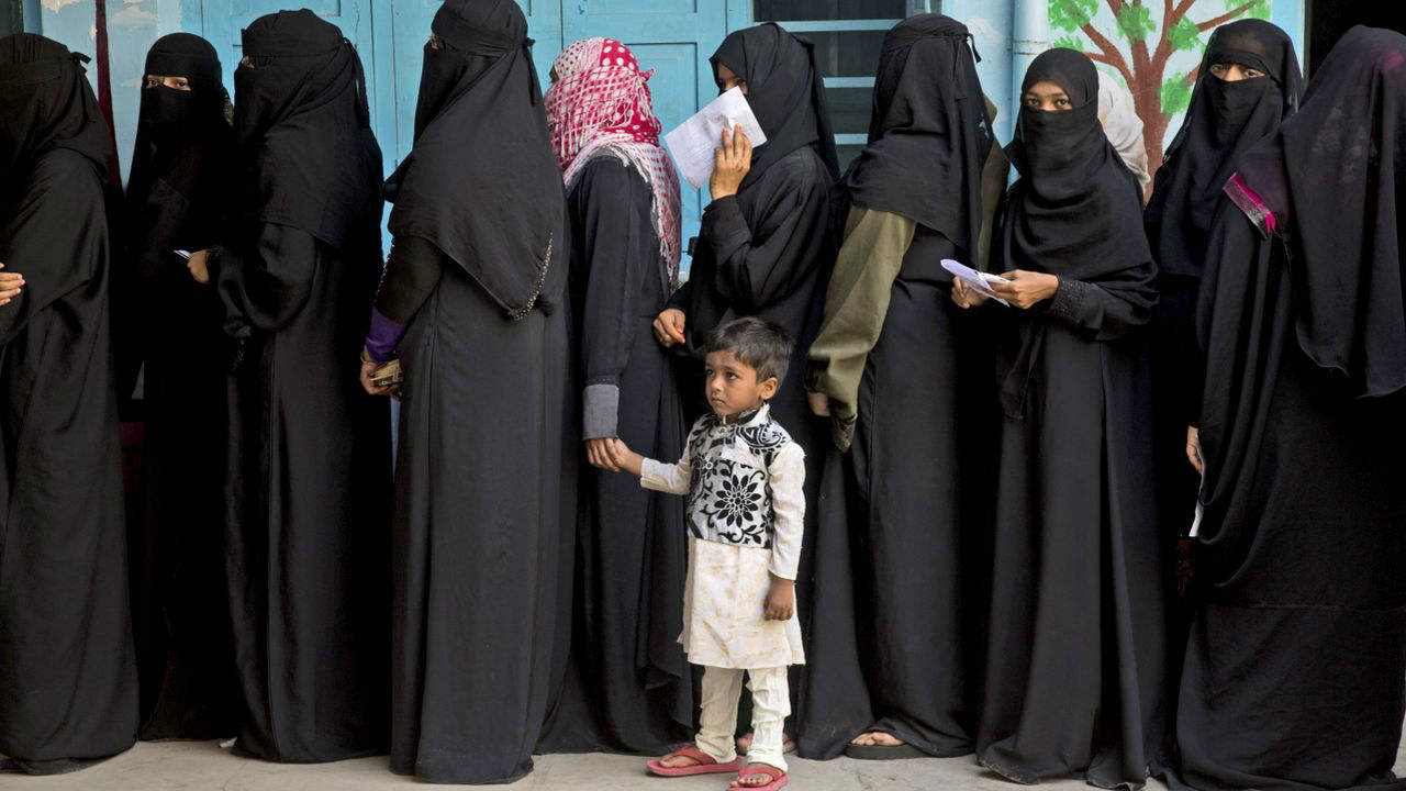 Muslim women queue up at a polling booth in Hyderabad. (Image: AP)