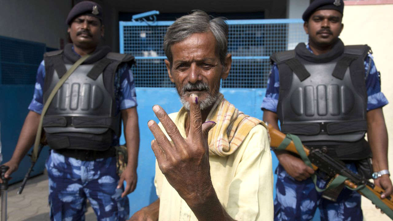 A local displays the indelible ink on his index finger after casting his vote in Hyderabad. (Image: AP)