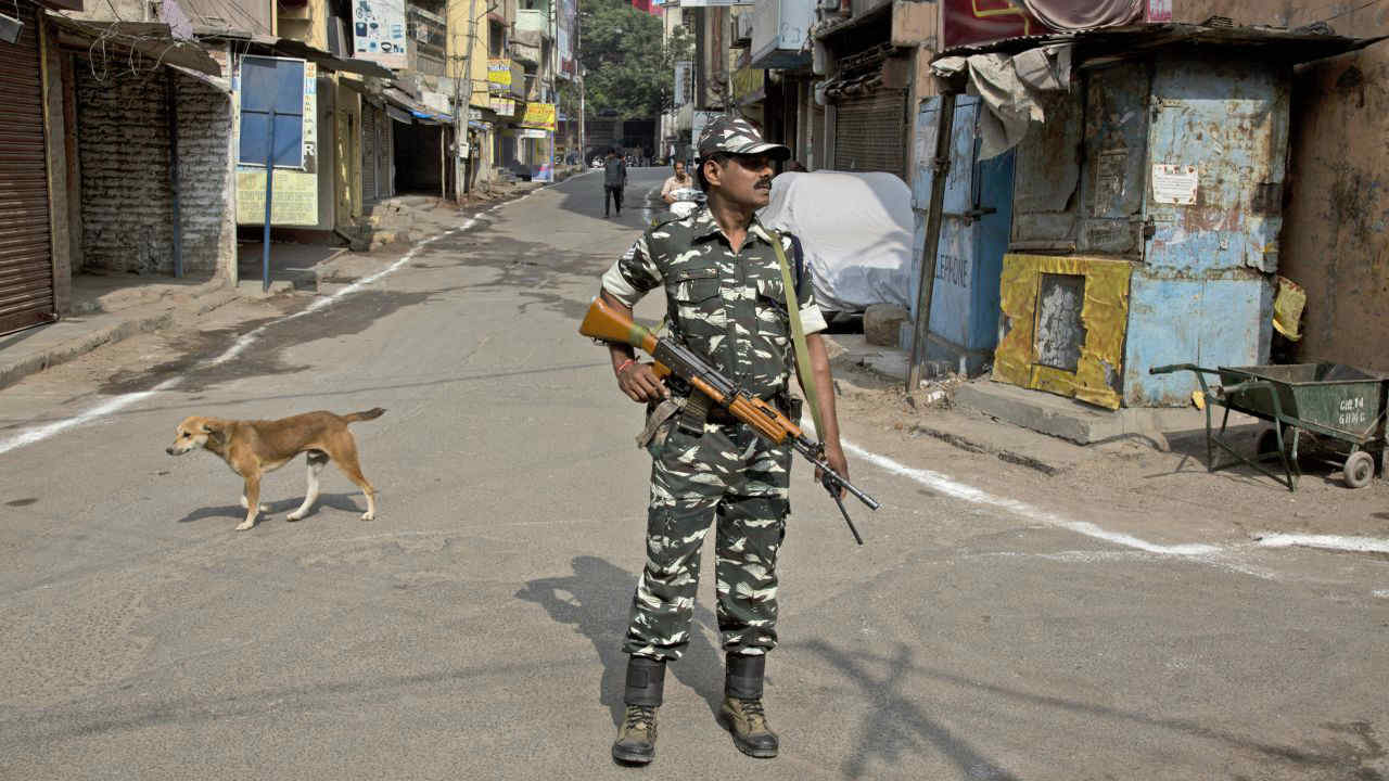 A paramilitary personnel stands guard during state elections in Hyderabad. (Image: AP)