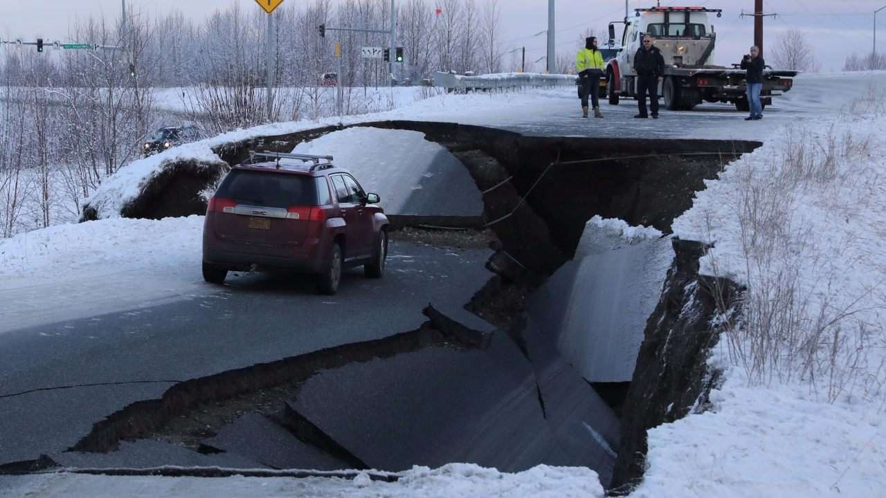 A stranded vehicle lies on a collapsed roadway near the airport after the earthquake in Anchorage. (Image: Reuters)