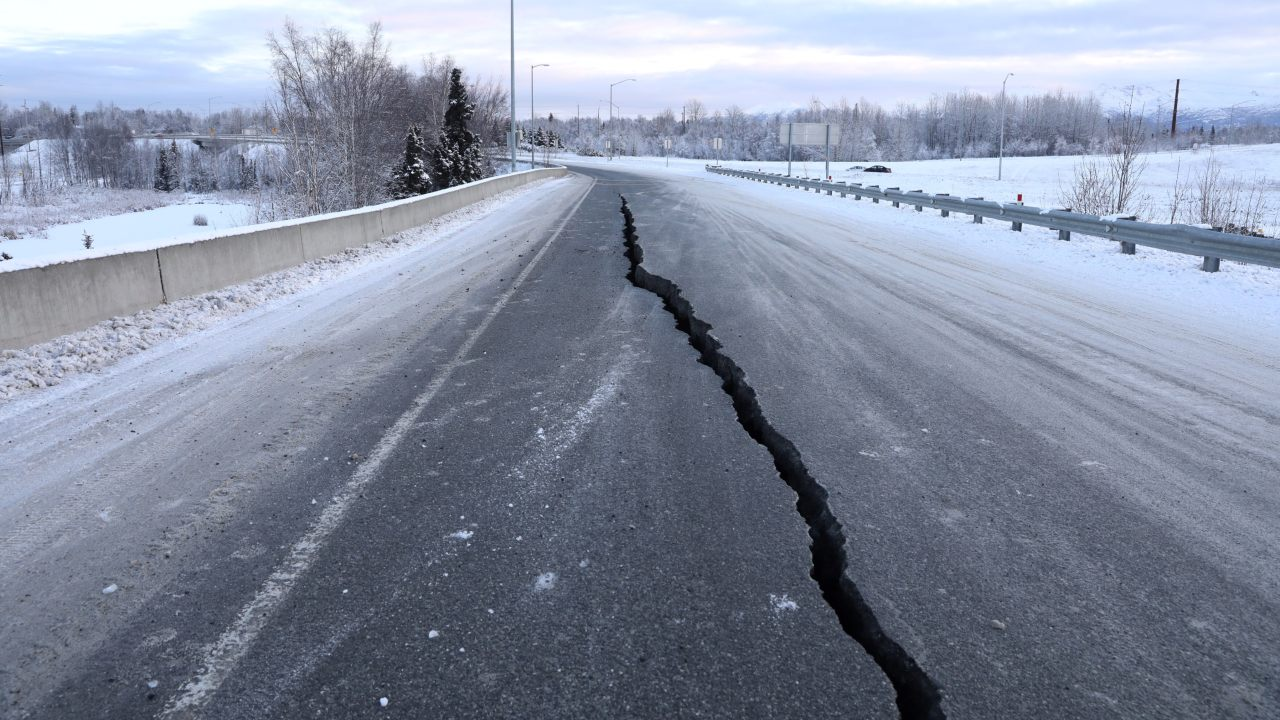 A crack which opened up along a roadway near the airport is seen after the earthquake. (Image: Reuters)