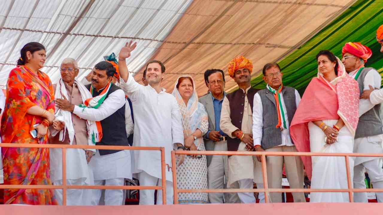 Congress President Rahul Gandhi waves at the crowd during an election campaign at Malakhera in Alwar. (Image: PTI)
