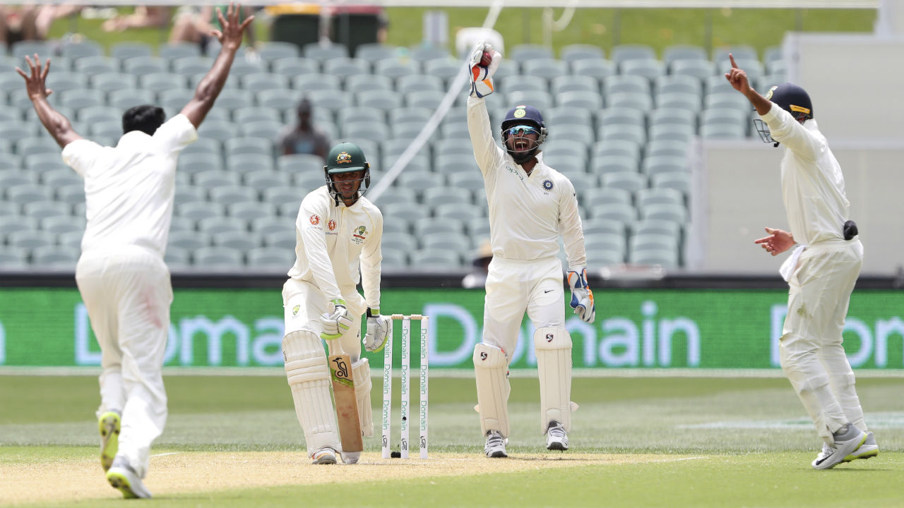 The Indian off-spinner added another dent to the Australian innings as he dismissed a solid looking Usman Khawaja. The ball from Ashwin kissed the batsman's gloves and Rishabh Pant completed an easy catch. Australia's score at the fall of Khawaja's wicket read 87/4. (Image: AP)