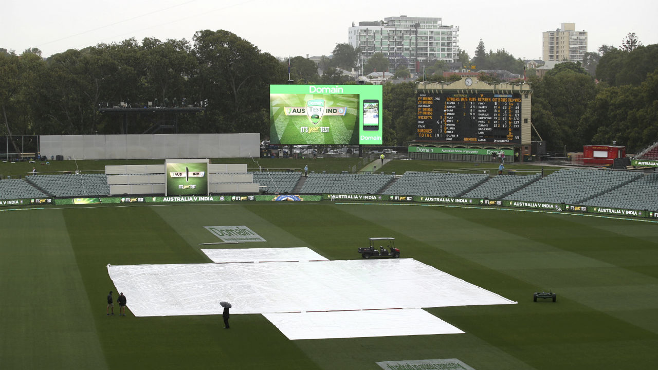 After two hot days in Adelaide there was downpour and as a result of which the play was stopped for sometime. (Image: AP)