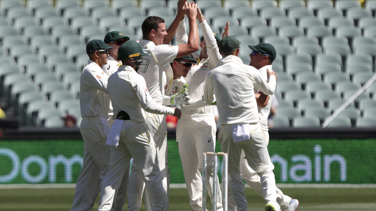 The Aussies drew first blood as they picked up the wicket of KL Rahul in just the second over of the morning. Aaron Finch standing at third slip took the catch off Josh Hazlewood's bowling. (Image: AP)