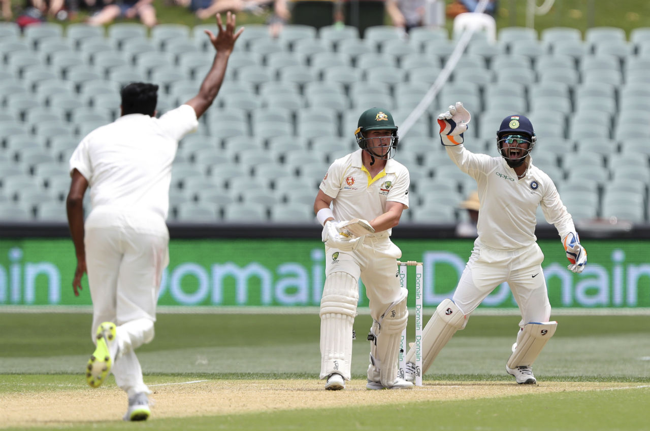 R Ashwin claimed the wicket of Harris to keep the Australian's in check. At the fall of the wicket Australia's score read 45/2. The off-spinner got the debutant caught by Murali Vijay at silly mid-off. Khawaja along with Shaun Marsh then took Australia to 57/2 at Lunch. (Image: AP)