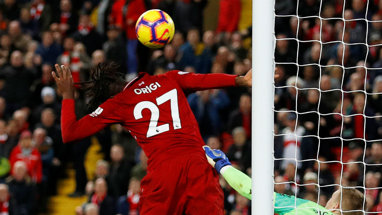 Liverpool 1 - 0 Everton | Liverpool's forgotten striker Divock Origi turned savior as he headed home a dramatic winner late in injury time to help his side snatch a victory against crosstown rival Everton at Anfield. The game had looked to be heading for stalemate before England No. 1 Pickford failed to deal with Virgil Van Dijk's mis-hit effort from the edge of the penalty area, leaving Origi to tap in from close range and extend Everton's 19-year wait for a win at Anfield. The game had looked to be heading for stalemate before England No. 1 Pickford failed to deal with Virgil Van Dijk's mis-hit effort from the edge of the penalty area, leaving Origi to tap in from close range and extend Everton's 19-year wait for a win at Anfield. The win helps Liverpool stay second in the league standing just two points adrift of leaders Manchester City. (Image: Reuters)