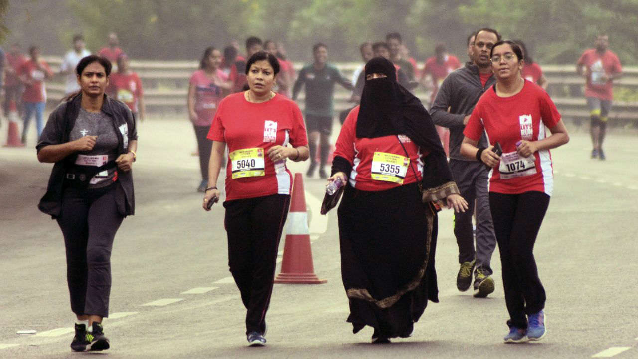 Participants at 'Lets Run Navi Mumbai Marathon' at Palm Beach Road in Navi Mumbai. (PTI)