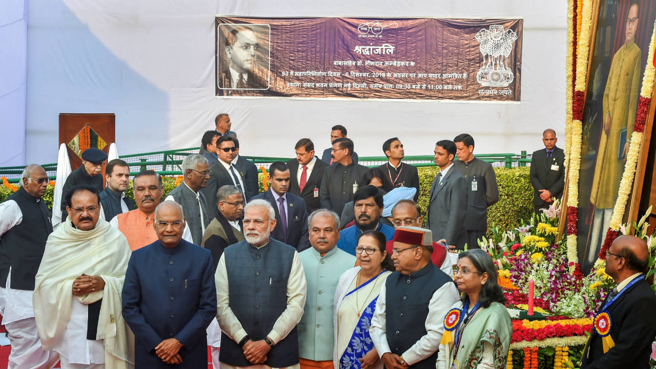 President Ram Nath Kovind, Vice President M Venkaiah Naidu, Prime Minister Narendra Modi and other dignitaries are seen during 'Mahaparinirvan Diwas', the death anniversary of BR Ambedkar at Parliament House Lawns in New Delhi. (Image: PTI)