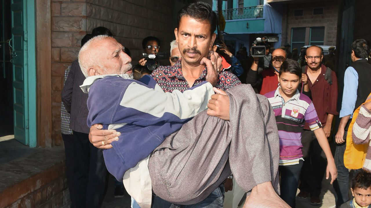 An elderly man being carried to a polling station in Jodhpur. (Image: PTI)
