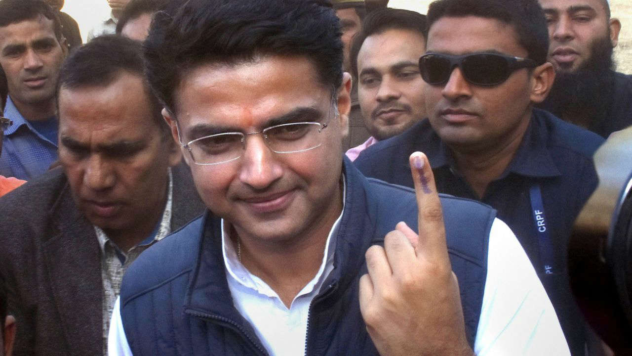 Rajasthan Congress chief Sachin Pilot shows his ink-marked finger after casting his vote in Jaipur. (Image: PTI)