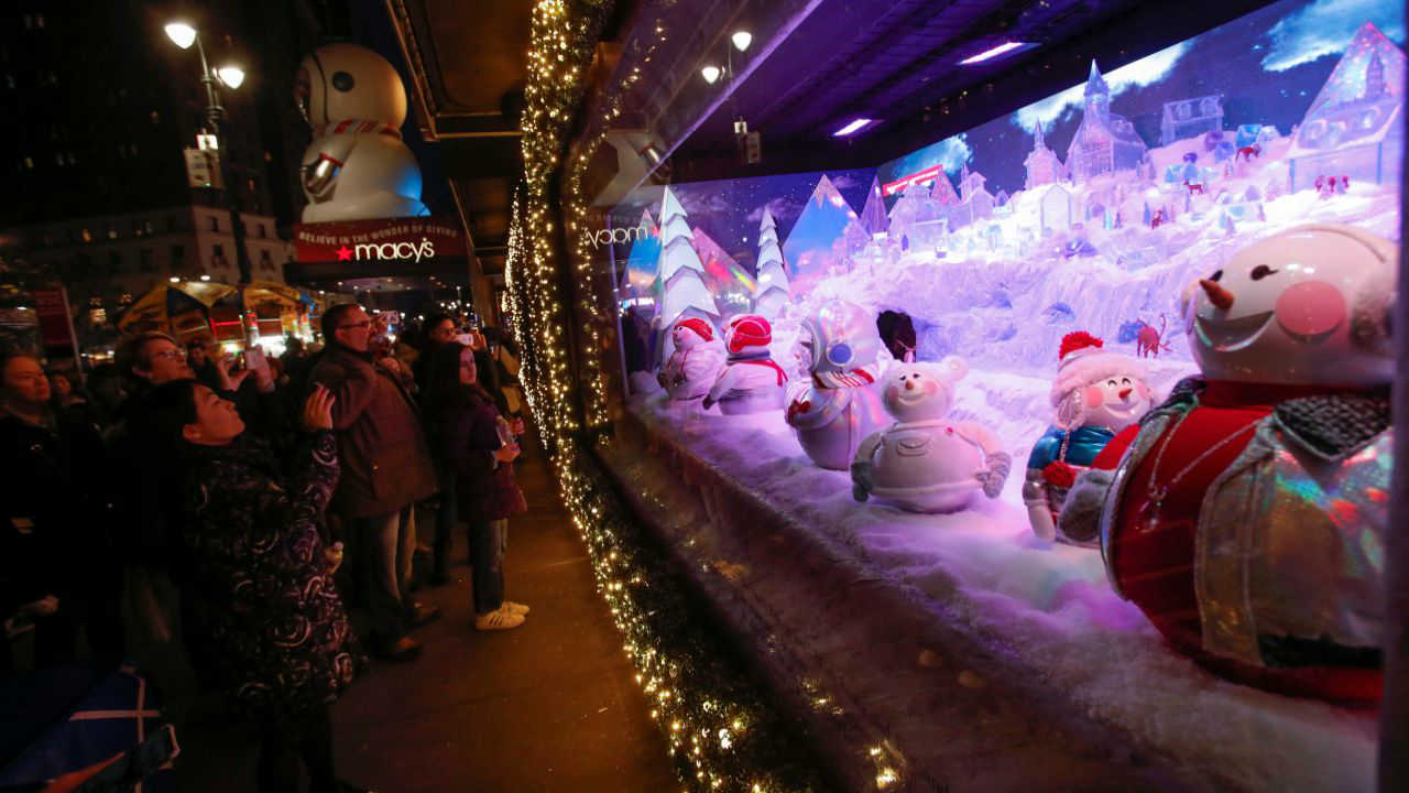 People gather to see the Christmas holiday window displays at Macy's Herald Square in Manhattan, New York City, US. (Reuters)