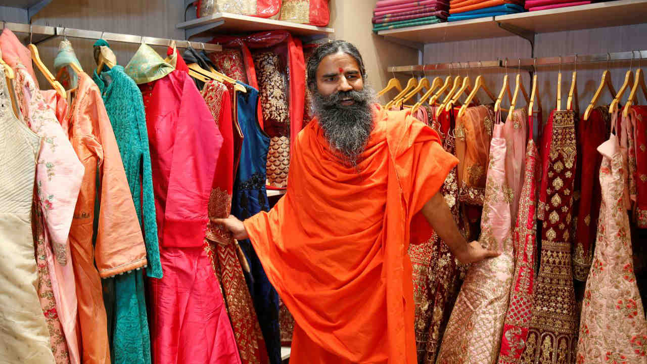 Yoga guru Baba Ramdev poses for a photograph during the opening of Patanjali Paridhan apparel store in Ahmedabad. (Reuters)