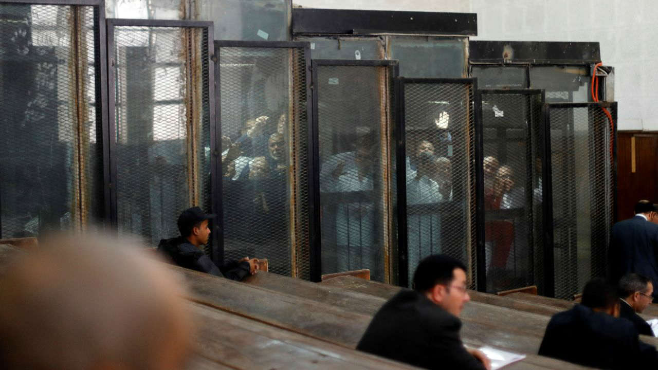 Muslim Brotherhood members are seen behind bars during a court session in Cairo, Egypt. (Reuters)