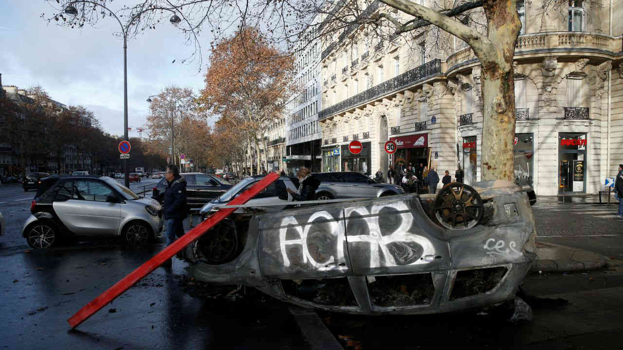 A vandalized car is seen the morning after clashes with protesters wearing yellow vests, a symbol of a French drivers' protest against higher diesel fuel taxes, in Paris, France. (Reuters)