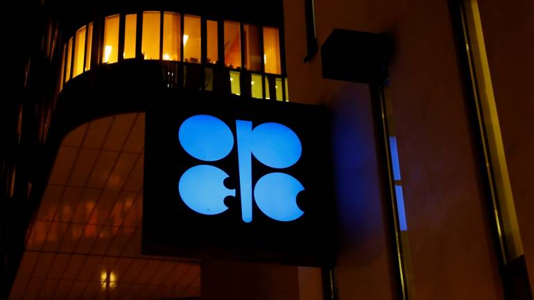 Oil gives up some of its OPEC gains as stock markets sag