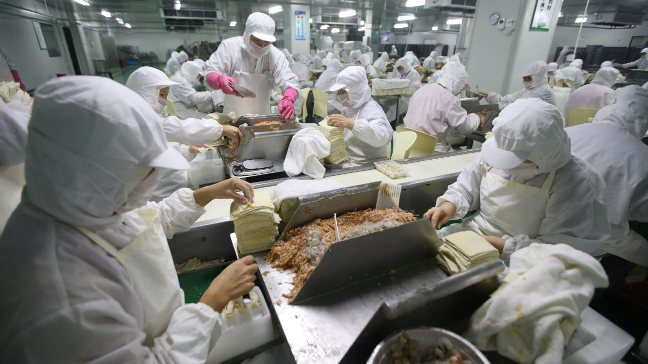Workers make wontons at a workshop in Shanghai, China. (Image: Reuters)