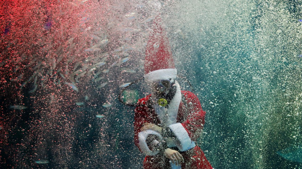 A diver dressed as Santa Claus performs during a promotional event for Christmas in Seoul, South Korea. (Image: Reuters)