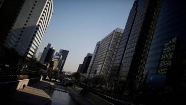 South Korea cuts GDP outlook, keeps policy of seeking equitable growth