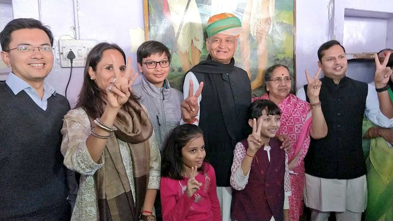 Congress leader Ashok Gehlot flashes the victory sign after casting his vote at a polling booth in Jodhpur. (Image: Twitter/@ashokgehlot51)