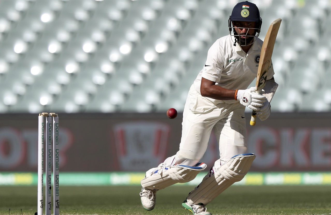Ravichandran Ashwin and Pujara then strung together India's only 50-plus partnership of the day. Pujara was brilliant right through his stay at the crease and brought up his fifty in the 59th over off 153 deliveries. He did a great job of frustrating the Australian bowlers with his compact style of play. (Image: AP)
