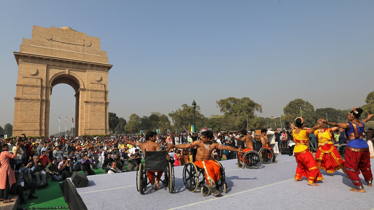 A group of differently-abled artists perform on a stage in front of India Gate at an event organised on the occasion of International Day of Disabled Persons, in New Delhi. Image: Reuters.