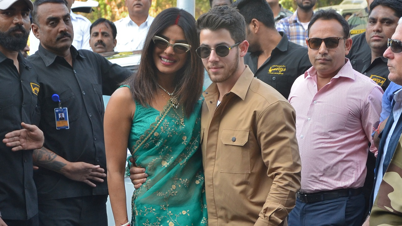 Bollywood actress Priyanka Chopra and her husband singer Nick Jonas pose outside the airport in Jodhpur in the desert state of Rajasthan, India. Image: Reuters