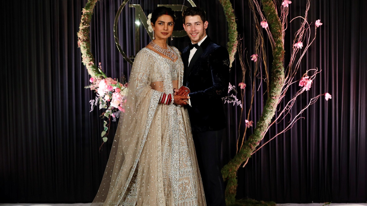 Bollywood actress Priyanka Chopra and husband Nick Jonas arrive for a photo opportunity at their wedding reception in New Delhi. (Image: Reuters)