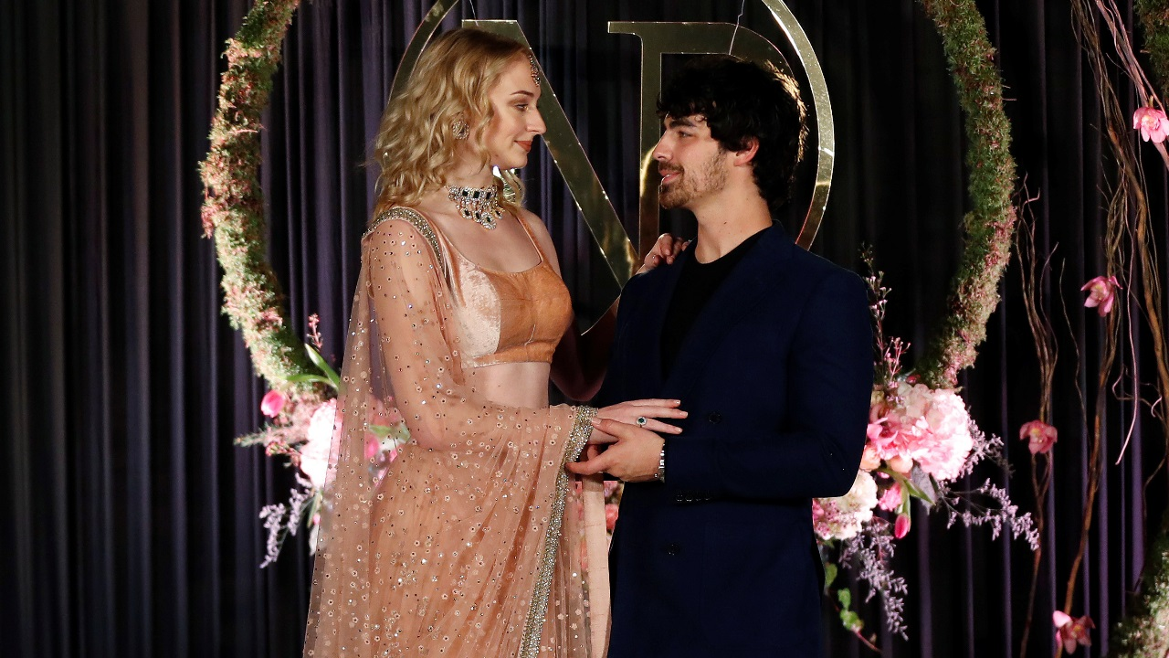 Actor Sophie Turner and singer Joe Jonas pose during a photo opportunity at the wedding reception of Priyanka Chopra and singer Nick Jonas, in New Delhi. (Image: Reuters)