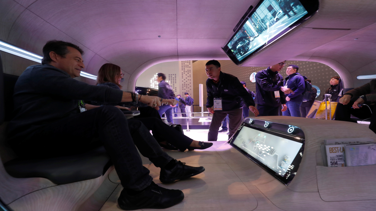 Passengers use gesture control to access functions in a mock-up of an autonomous vehicle at the Kia booth during CES 2019 at Las Vegas. (Image: Reuters)